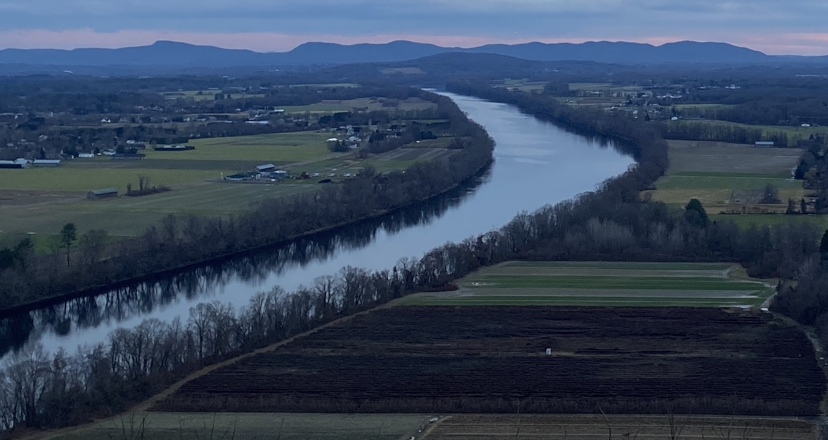 Connecticut River winding through farmland. View is from Mount Sugarloaf in the north, with the Holyoke Range visible in the south.